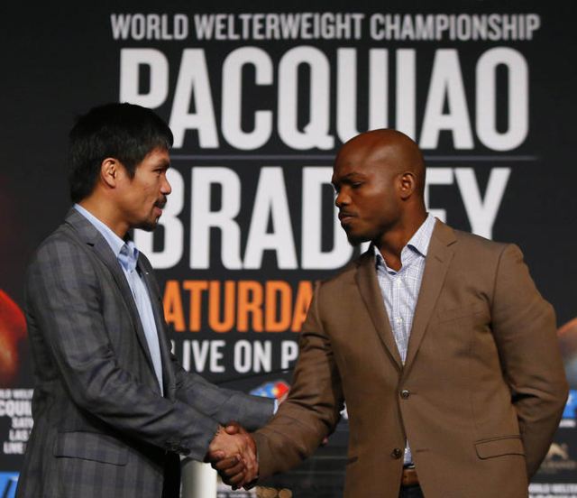 Jan 21, 2016; New York, NY, USA; Manny Pacquiao and Timothy Bradley, Jr. shake hands during press conference at Madison Square Garden to announce the upcoming boxing fight on April 9, 2016 in Las  ...