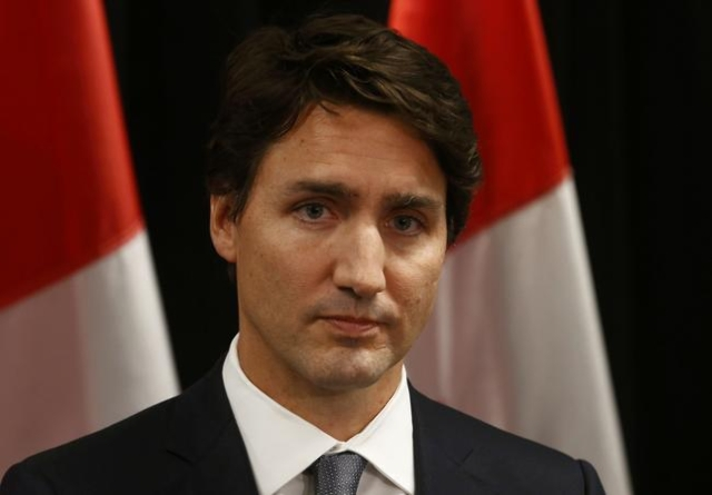 Canadian Prime Minister Justin Trudeau speaks about a Saskatchewan school shooting during a news conference in Davos, January 22, 2016.   At least five people were killed and two people were injur ...