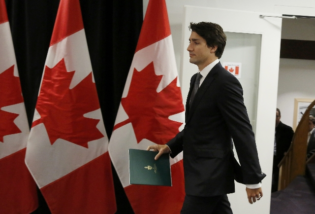 Canadian Prime Minister Justin Trudeau arrives to speak about a Saskatchewan school shooting during a news conference in Davos, January 22, 2016. (Ruben Sprich/Reuters)
