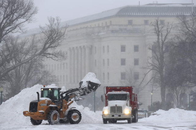 A heavy earth moving machine is used to clear snow on Capitol Hill during a winter storm in Washington January 23, 2016. (Joshua Roberts/Reuters)