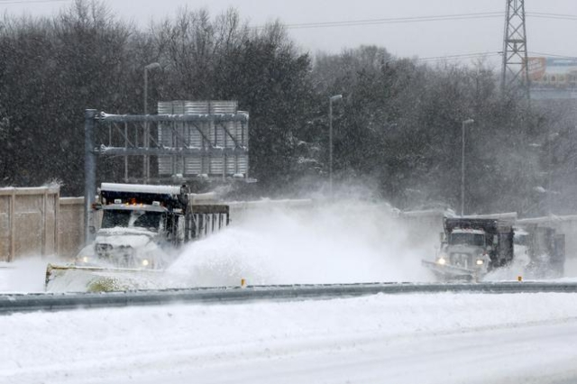 Plow teams clear I-295 during a winter storm in Trenton, New Jersey, January 23, 2016. More than two feet (60 cm) of snow is expected to fall in the first major storm of the season. REUTERS/Domini ...