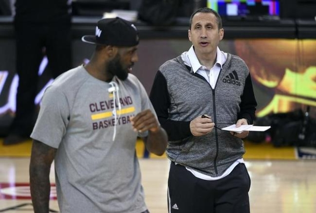 Cleveland Cavaliers head coach David Blatt talks with forward LeBron James (23) during practice prior to the NBA Finals at Oracle Arena. Mandatory Credit: Kyle Terada-USA TODAY Sports