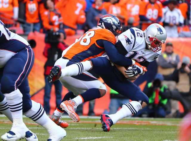 New England Patriots quarterback Tom Brady (12) is sacked by Denver Broncos outside linebacker Von Miller (58) in the second half in the AFC Championship football game at Sports Authority Field at ...