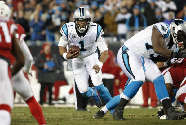 Carolina Panthers quarterback Cam Newton (1) runs the ball during the first quarter against the Arizona Cardinals in the NFC Championship football game at Bank of America Stadium. Mandatory Credit ...