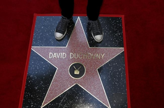 Actor David Duchovny stands on his star after it was unveiled on the Hollywood Walk of Fame in Los Angeles, California January 25, 2016.   REUTERS/Mario Anzuoni