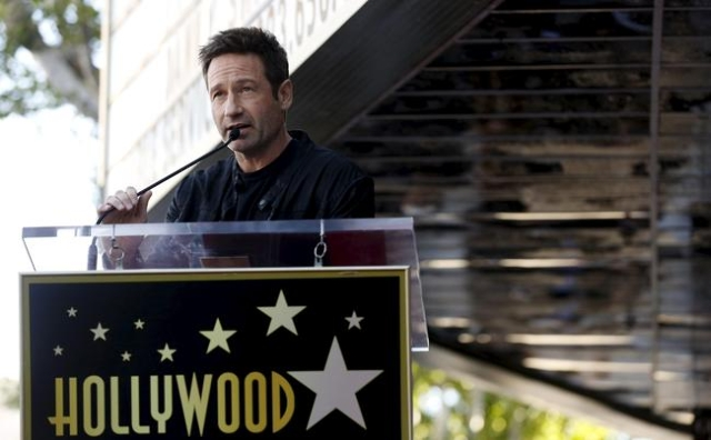 Actor David Duchovny speaks before unveiling his star on the Hollywood Walk of Fame in Los Angeles, California January 25, 2016.   REUTERS/Mario Anzuoni