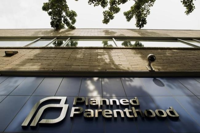 A sign is pictured at the entrance to a Planned Parenthood building in New York August 31, 2015. (Lucas Jackson/Reuters)