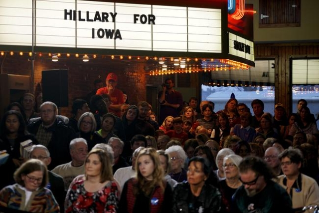 People listen to Hillary Clinton speaking at a campaign event in Oskaloosa, Iowa January 25, 2016.   REUTERS/Rick Wilking -