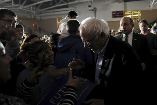 Bernie Sanders greets supporters after speaking during a campaign event at Grinnell College in Grinnell, Iowa January 25, 2016. REUTERS/Mark Kauzlarich