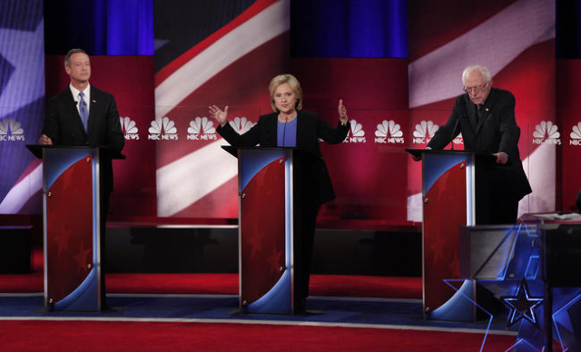 U.S. presidential candidate Hillary Clinton speaks as she discusses issues with former Governor Martin O'Malley (L) and Senator Bernie Sanders at the NBC News - YouTube Democratic presidenti ...