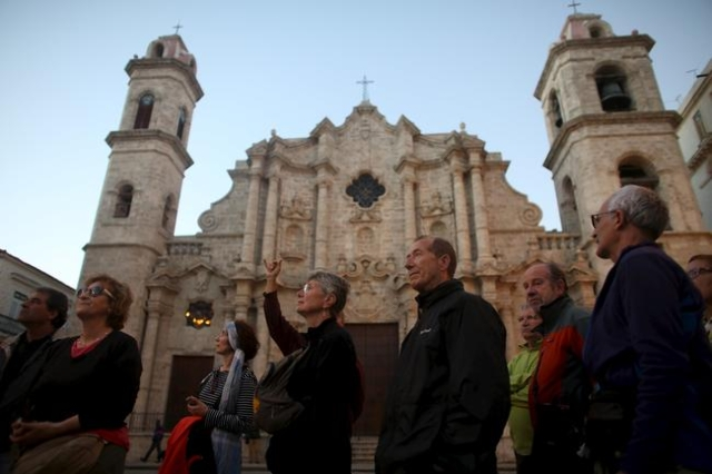 Tourists from Spain take a guided tour in old Havana, January 25, 2016. REUTERS/Alexandre Meneghini
