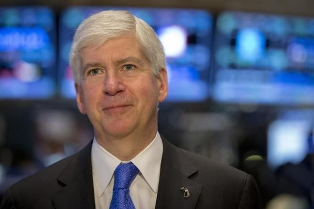 Michigan Governor Rick Snyder gives an interview on the floor of the New York Stock Exchange May 8, 2015. (Brendan McDermid/Reuters)