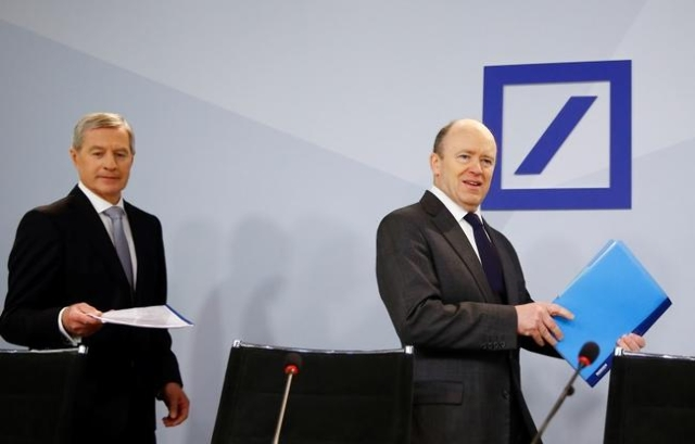 Deutsche Bank co-CEO Juergen Fitschen and Chief Executive John Cryan (R) arrive for a news conference in Frankfurt, Germany, January 28, 2016. (Kai Pfaffenbach/Reuters)