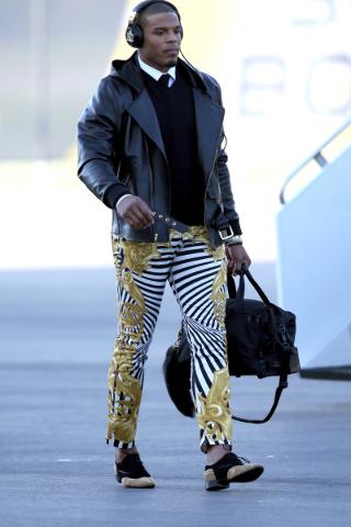 Jan 31, 2016; San Jose, CA, USA; Carolina Panthers quarterback Cam Newton walks after exiting a plane during team arrivals at the Mineta San Jose International Airport in preparation of Super Bowl ...