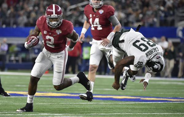 Dec 31, 2015; Arlington, TX, USA; Alabama Crimson Tide running back Derrick Henry (2) runs the ball for a touchdown past Michigan State Spartans defensive end Shilique Calhoun (89) during the four ...