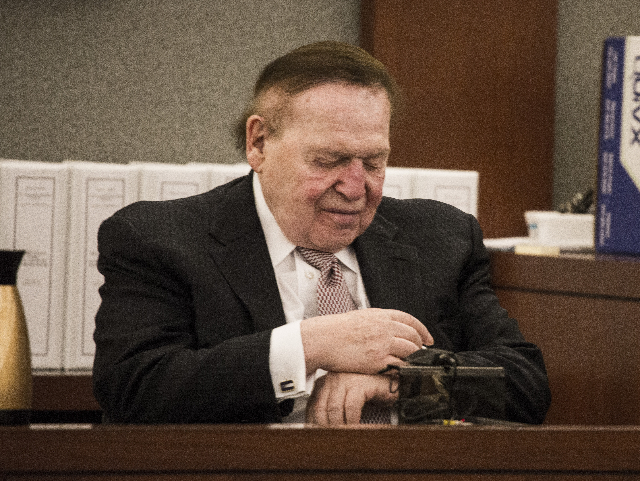 Las Vegas Sands Corp. Chairman and CEO Sheldon Adelson,  checks his watch while taking the  witness stand at Clark County Justice Center on Tuesday, April 28, 2015.   (Jeff Scheid/Las Vegas Review ...