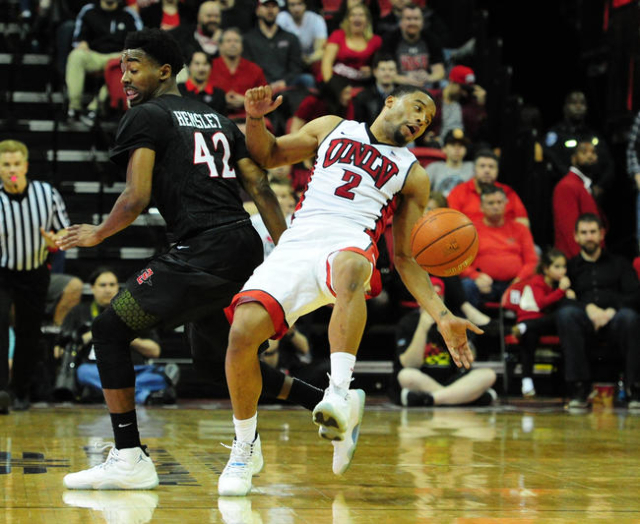 UNLV guard Jerome Seagears (2) falls after catching an inbounds pass as San Diego State guard Jeremy Hemsley (42) defends in the second half of their NCAA college basketball game at the Thomas &am ...