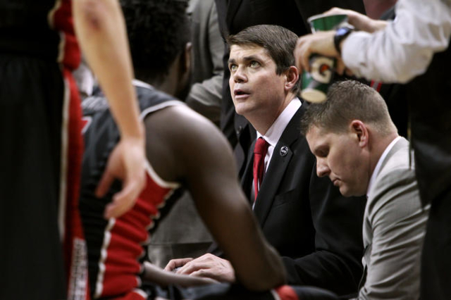UNLV head coach Dave Rice talks to his players during a time out in the second half of their Mountain West Conference tournament quarterfinal game against San Diego State Thursday, March 12, 2015, ...