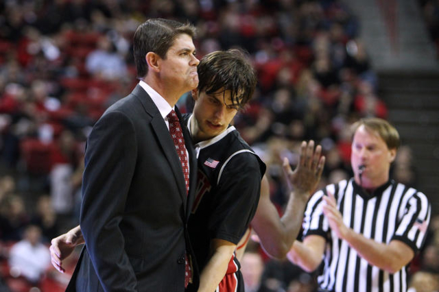 UNLV guard Cody Doolin bumps into a frowning head coach Dave Rice as they head to a timeout after a Boise State basket during the second half of their Mountain West Conference game Wednesday, Feb. ...