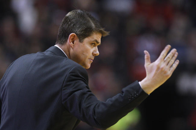 UNLV head coach Dave Rice motions for his players to get up the floor during the second half of their Mountain West Conference game against Boise State Wednesday, Feb. 18, 2015, at the Thomas &amp ...