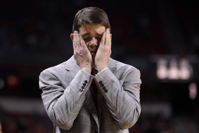 UNLV head coach Dave Rice covers his face in frustration after a Rebels turnover to Utah State during the second half of their Mountain West Conference game Saturday, Jan. 24, 2015, at the Thomas  ...