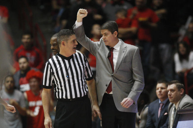 UNLV head coach Dave Rice questions a call by official Brad Ferrie during the first half of their Mountain West Conference game Saturday, Feb. 21, 2015, at The Pit in Albuquerque. (Sam Morris/Las  ...
