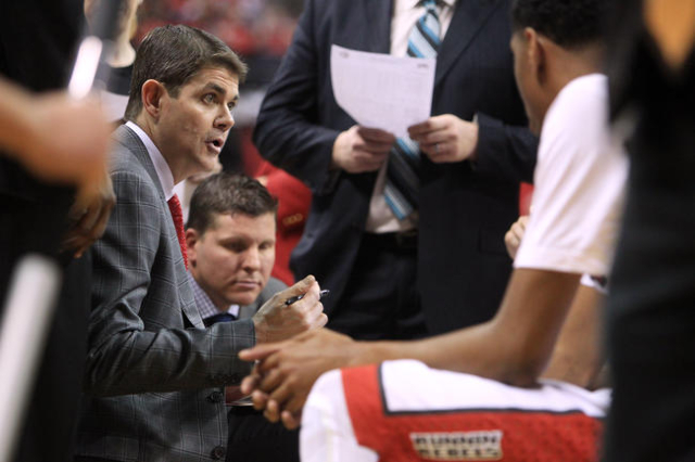 Head coach Dave Rice talks to his team during a time out in their game against Southern Utah Saturday, Dec. 27, 2014 at the Thomas & Mack Center. UNLV won the game 79-45. (Sam Morris/Las Vegas ...