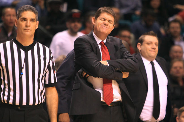 UNLV head coach Dave Rice winces after an offensive Rebel foul during their MGM Grand Showcase game against Utah Saturday, Dec. 20, 2014. Utah won 59-46. (Sam Morris/Las Vegas Review-Journal)