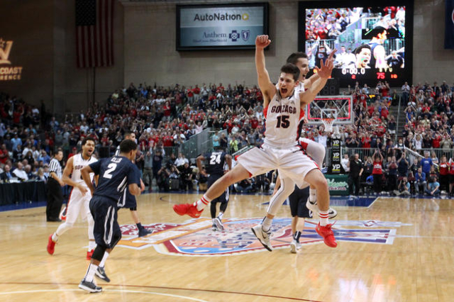 Gonzaga guards Rem Bakamus and Kyle Dranginis celebrate as time expires in their 91-75 victory over BYU in the West Coast Conference championship game March 10, 2015, at the Orleans Arena. The WCC ...