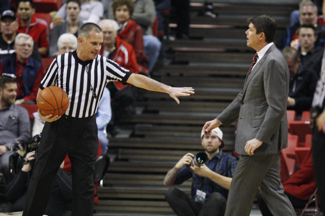 NCAA official Kelly Self tells UNLV head coach Dave Rice to get back to his bench during the first half of their Mountain West Conference game Saturday, Feb. 28, 2015, at the Thomas & Mack Cen ...