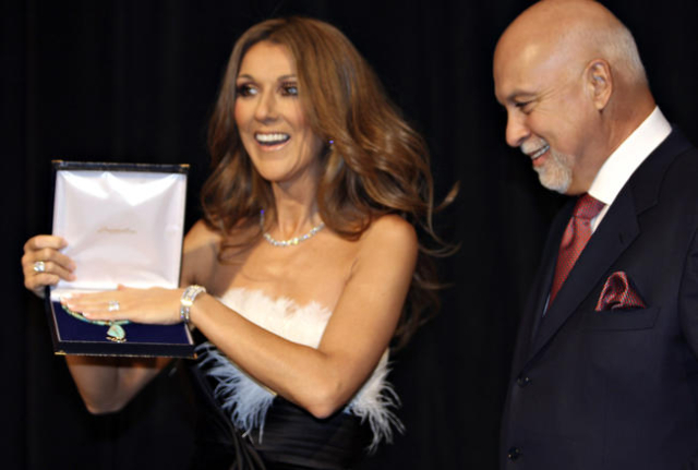 Entertainer Celine Dion holds a Nevada-mined turquoise necklace presented to her by Nevada first lady Dawn Gibbons, with her husband, Rene Angelil, beside her, Dec. 13, 2007, at Caesars Palace. (J ...