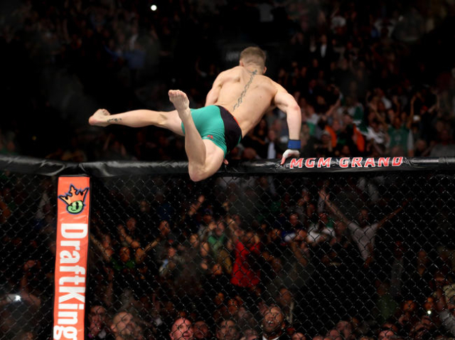 Conor McGregor celebrates after his defeat of Jose Aldo  by a first round knock out during a featherweight title bout at UFC 194 at the MGM Grand Garden Arena on Saturday, Dec. 12, 2015, in Las Ve ...