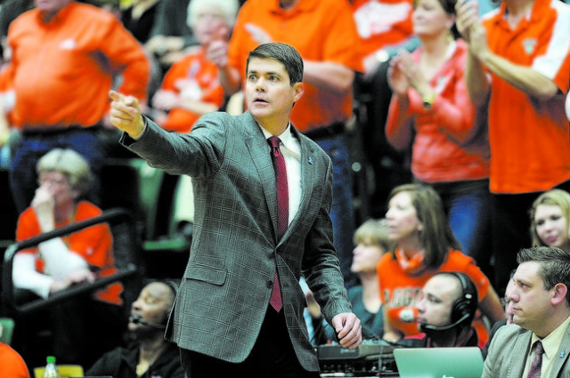 Feb 7, 2015; Fort Collins, CO, USA; UNLV Rebels head coach Dave Rice calls out from his sideline in second half against the Colorado State Rams at Moby Arena. The Rams defeated the Rebels 83-82. M ...