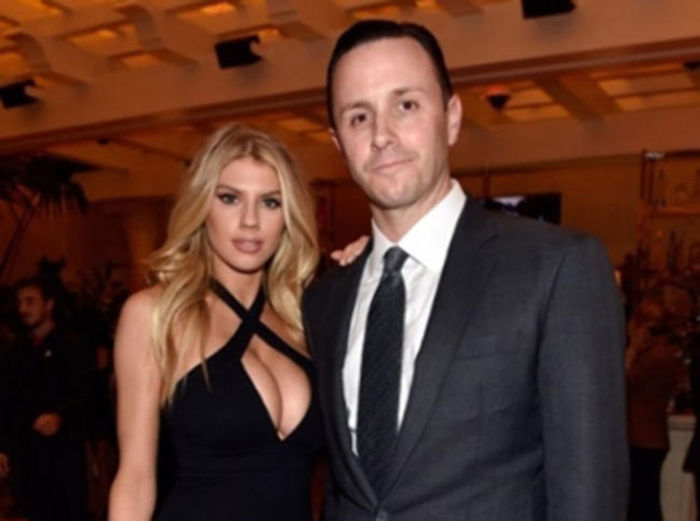 Wynn Las Vegas executive Sean Christie and model Charlotte McKinney attend Wednesday's grand opening of Encore Players Club. (Courtesy of David Becker/Getty Images)