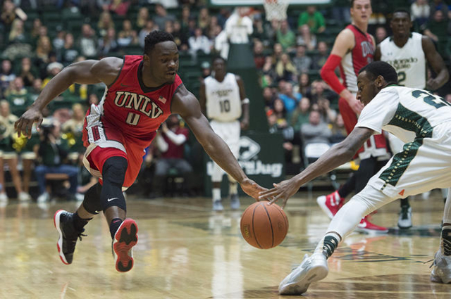 Ike Nwamu of UNLV moves in to regain possession of the ball during a game against CSU at Moby Arena Wednesday, January 6, 2016. (Austin Humphreys/The Coloradoan)