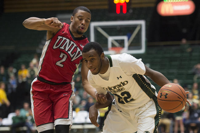 CSU guard J.D. Paige drives the ball around UNLV guard Jerome Seagears during a game at Moby Arena Wednesday, January 6, 2016. (Austin Humphreys/The Coloradoan)