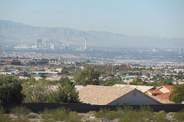 A view from the River Mountain Loop trail shows rooftops in Henderson with the Strip and the Stratosphere Tower in the distance on Tuesday, Dec. 1, 2015. (Greg Haas/Las Vegas Review-Journal)