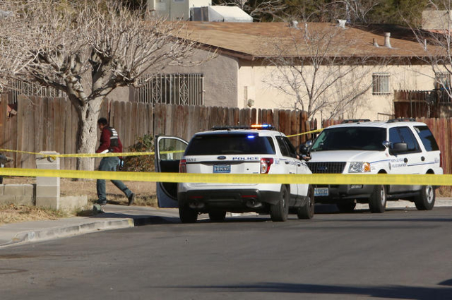 North Las Vegas police are investigating a homicide at a house in the 1200 block of Ferguson Avenue, near the intersection of Evans Avenue and Civic Center Drive, on Monday, Jan. 25, 2016.  (Bizua ...