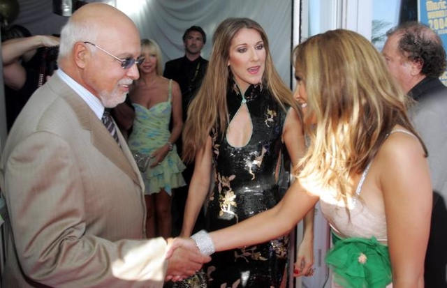 Singing superstar Celine Dion, center, introduces her husband, Rene Angelil, to actress/singer Jennifer Lopez as they arrive at the 2004 World Music Awards at the Thomas & Mack Center in Las V ...