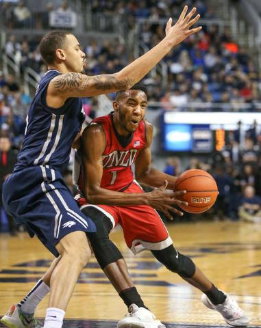 UNLV's Derrick Jones, Jr. pushes past Nevada's Kaileb Rodriguez during a men's college basketball game in Reno, Nev., on Saturday, Jan. 23, 2016. Cathleen Allison/Las Vegas Revie ...