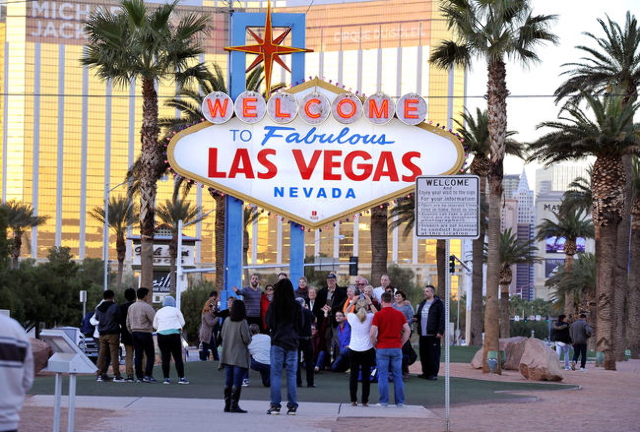 Tourists take photos of themselves at the Welcome to Fabulous Las Vegas sign on Tuesday, Nov. 25, 2014, in Las Vegas. (David Becker/Las Vegas Review-Journal)