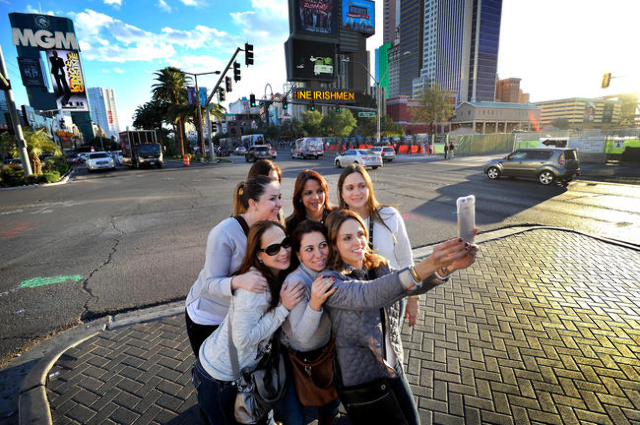 Tourists stop in the median along Las Vegas Boulevard to snap photographs of themselves in Las Vegas on Thursday, Feb. 26, 2015. (David Becker/Las Vegas Review-Journal)