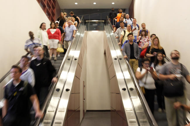 Passengers make their way to baggage claim at McCarran Airport on Tuesday, June 2, 2015 in Las Vegas. Clark County Commission has approved rate changes that makes it more affordable to bring a pas ...