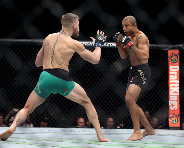 Conor McGregor, left, and Jose Aldo face each other down during a featherweight title bout at UFC 194 at the MGM Grand Garden Arena on Saturday, Dec. 12, 2015, in Las Vegas. McGregor won by a firs ...