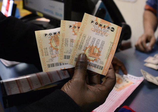 A customer shows their tickets for the Powerball lottery at the California lotto store in San Bernardino County, Calif., on the California-Nevada state line January 9, 2016.  (REUTERS/Gene Blevins)