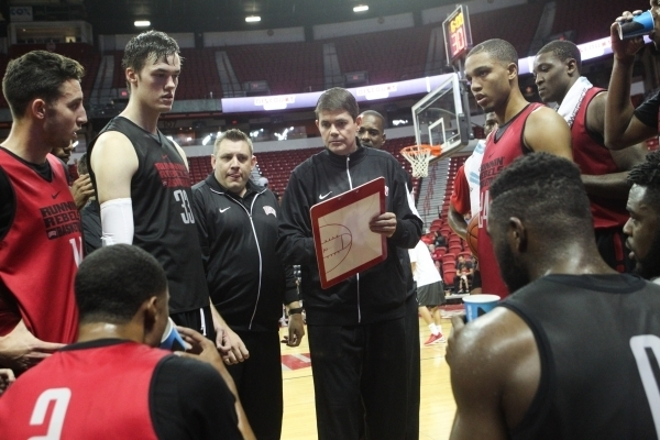 UNLV head coach Dave Rice, center, talks with the team during the Scarlet and Gray scrimmage at the Thomas & Mack Center in Las Vegas on Thursday, Oct. 15, 2015. Chase Stevens/Las Vegas Review ...