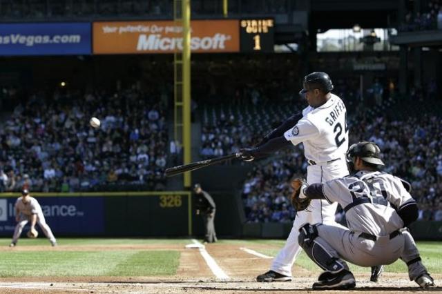 Seattle Mariners' Ken Griffey Jr. doubles off New York Yankees starting pitcher Joba Chamberlain, scoring teammate Jose Lopez during the first inning of their MLB American League baseball ga ...