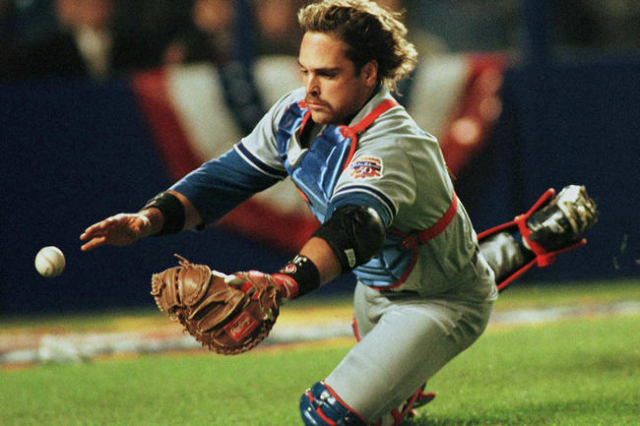 Los Angeles Dodgers catcher Mike Piazza dives for a foul bunt off the bat of New York Mets batter Alex Ochoa but misses in the fifth inning of the game April 15 at Shea Stadium in New York. (Reute ...