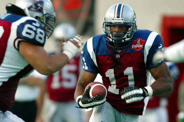 Former Montreal Alouettes running back Lawrence Phillips (11) runs for a gainduring the first quarter of CFL action against the SaskatchewanRoughriders in Montreal, July 11, 2002. (Shaun BestSB/ME ...