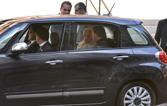 Pope Francis sits in the backseat of a small Fiat automobile as he arrives for a prayer service and meeting with U.S. bishops, at the Cathedral of St. Matthew the Apostle, in Washington, September ...